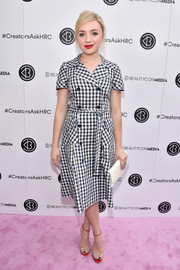 Peyton List was a total cutie in this double-breasted gingham-print dress at the Beautycon Media event with Hillary Clinton.