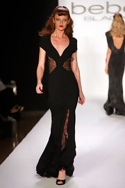 Cintia Dicker rocked the runway wearing one of Bebe's creations -- a long black gown with lace cutouts on the waist and legs.