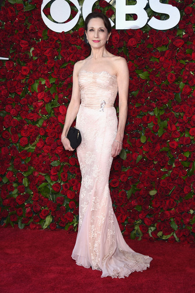 Bebe Neuwirth Strapless Dress [gown,flooring,dress,carpet,lady,beauty,fashion model,red carpet,wedding dress,bridal clothing,arrivals,bebe neuwirth,tony awards,the beacon theatre,new york city]