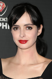 Krysten exuded Old Hollywood glamour with cherry red lips at Beck's Sapphire Launch event.