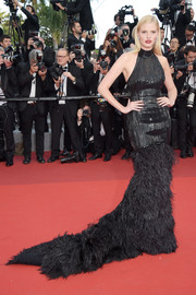 Lara Stone went goth-glam in a black Balmain halter gown with a feather-festooned hem at the Cannes Film Festival screening of 'The Beguiled.'