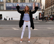 Behati Prinsloo jazzed up her casual jeans and tee combo with a black fur-trimmed coat during the Victoria's Secret T-shirt bra launch.