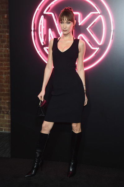Bella Hadid Knee High Boots [clothing,dress,lady,pink,light,beauty,cocktail dress,fashion,little black dress,lighting,bella hadid,spring,new york city,dolby soho,launch party,jump into spring,michael michael kors spring 2019]