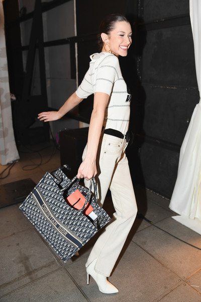 Bella Hadid Printed Tote [the shows,shoulder,clothing,fashion,footwear,leg,bag,shoe,joint,handbag,satchel,brandon maxwell - front row,brandon maxwell,bella hadid,front row,new york city,penn plaza pavilion,new york fashion week]