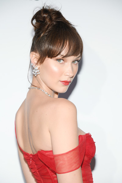 Bella Hadid Hair Knot [hair,face,hairstyle,shoulder,red,beauty,lip,chin,skin,lady,bella hadid,cannes,france,jw marriott,dior dinner arrivals,cannes film festival,dinner]
