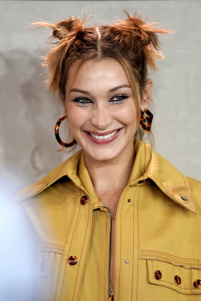 Bella Hadid Hair Knots [hair,hairstyle,forehead,brown hair,hair coloring,long hair,smile,feathered hair,bella hadid,fendi - backstage,milan,italy,fendi,milan fashion week,fashion show,milan fashion week spring]