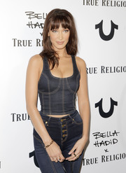 Bella Hadid attended the True Religion event wearing a classic gold link bracelet.