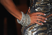 Barbara added some major bling to her already shimmering dress with layered diamond bracelets.
