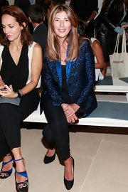 Nina Garcia polished off her look at the Belstaff Spring 2013 fashion show with a blue and black print blazer.
