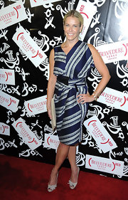 Chelsea Handler donned a ladylike dress at the Belvedere soiree. She opted for a blue and gray print dress with a cinched waist and asymmetrical neckline.