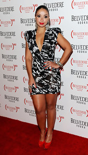 Mya added a splash of color to her black and white mini dress with red patent platform pumps.