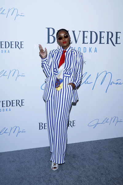 Janelle Monae donned a blue and white striped pantsuit with a nautical-print tie for the Belvedere Vodka 'Beautiful Future' limited edition bottle celebration in Chicago.