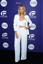 Arielle Kebbel looked sharp and sexy in a white pantsuit teamed with a tight crop-top at the onePULSE Foundation benefit.