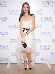 Georgina Chapman was a feathered beauty in this white dress at the Bergdorf Goodman anniversary celebration.