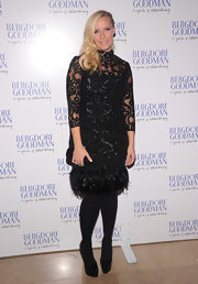 Karen's ornate LBD at the Bergdorf Goodman anniversary celebration had a feathered trim.