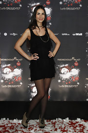 Sila Sahin's two-tone ankle-boots provided a tough contrast to her frilly LBD.