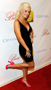 The ultra girly Holly Madison pairs these flirty pink ankle strap pumps with her low cut LBD. Very cute.