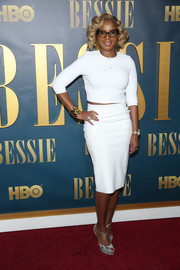 Mary J. Blige injected a touch of print with a pair of gray snakeskin platform peep-toes.