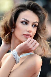 Madalina Ghenea wore this beaded wrap bracelet at the Cannes Film Fest.