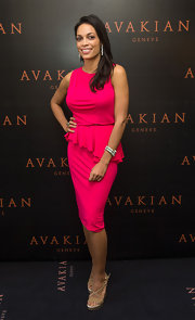 Rosario shined in a hot pink sleeveless dress with an asymmetrical ruffle at the waist.