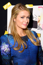 Paris Hilton styled her hair in a mildly messy half-up 'do for the Betsey Johnson fashion show.