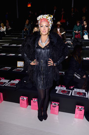 Neon Hitch was a head turner in a thick black fur coat layered over a fringed LBD during the Betsey Johnson fashion show.