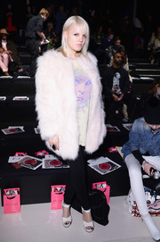Becka Diamond glammed up her casual tee and jeans combo with a luxurious white fur coat during the Betsey Johnson fashion show.