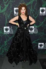 Bernadette Peters got glammed up in an embroidered velvet ball gown for the 2017 Hulaween event.