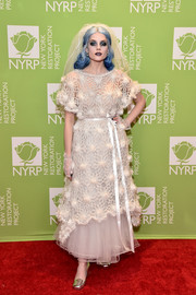Though she came dressed as a horror bride for Bette Midler's Hulaween party, Lucy Boynton hardly scared us with this cute white tulle gown with a crochet overlay.