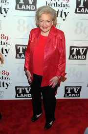 Betty was bright red in a brocade evening coat and coordinating blouse at her 89th birthday party.