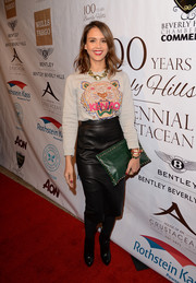 Jessica Alba styled her sweater with a black leather pencil skirt.