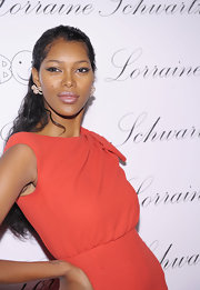 Jessica White paired a stunning red dress with diamond studs in the shape of a bow.