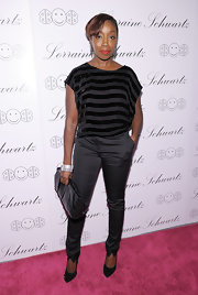 Estelle toughened up her skinny trousers with black stud-embellished pumps. The heels matched her oversize leather Chanel clutch.