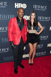 Tyson Beckford's red blazer added a bit of spunk to the model's red carpet look.