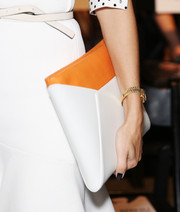 Olivia Palermo carried this stylish two-tone envelope clutch when she attended the Bibhu Mohapatra fashion show.