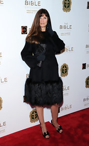 Carol Alt showed off her elegant style with this black evening coat with a thick fur hem.