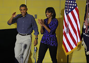 Michelle Obama participated in the National Day of Service wearing a purple and black print blouse.