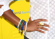 Tichina Arnold added some color to her white button-down with a bunch of beaded bracelets at the Get Schooled Initiative launch.