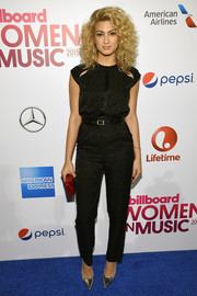 Tori Kelly kept it low-key in a black Tamara Mellon jumpsuit with shoulder cutouts during Billboard's Women in Music event.
