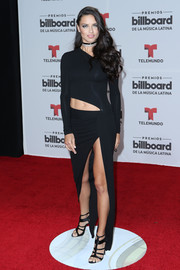 Adriana Lima complemented her dress with strappy black heels by Paul Andrew.