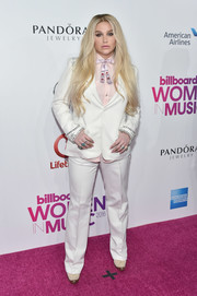 Kesha went for a white pantsuit and pink shirt combo when she attended the Billboard Women in Music 2016.