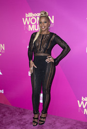 Mary J. Blige looked va-va-voom in a black mesh-panel catsuit by Julien Macdonald at the 2017 Billboard Women in Music event.