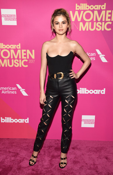 Selena Gomez kept the fierceness coming with a pair of slashed leather pants, also by Versace.