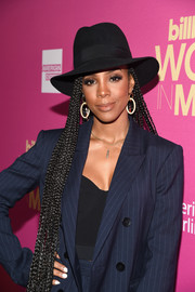 Kelly Rowland paired a black fedora with a navy pinstriped suit for a menswear-chic look.