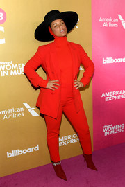 Alicia Keys couldn't be missed in her bright red pantsuit at the 2018 Billboard Women in Music event.