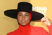 Alicia Keys punctuated her red outfit with a black wide-brimmed hat when she attended the 2018 Billboard Women in Music event.