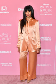Jameela Jamil looked striking in an oversized peach satin pantsuit by Annakiki at the Billboard Women in Music 2019.
