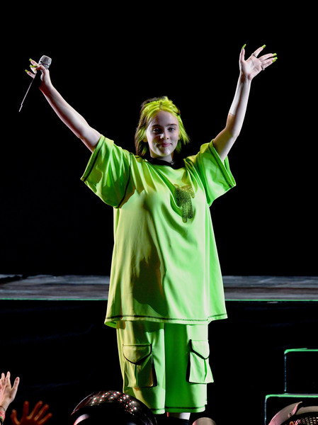 Billie Eilish Long Shorts [performance,green,performing arts,event,public event,human body,stage,performance art,gesture,music,billie eilish,camila cabello,becky g,jonas brothers,lizzo,marshmello,we can survive,radio.com presents,taylor swift,the hollywood bowl]