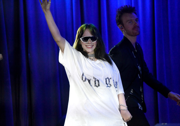 Billie Eilish arrived for a performance at the Grammy Museum wearing a pair of athletic shield sunglasses.