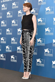 Emma Stone teamed her crop-top with a pair of black-and-white print pants, also by Proenza Schouler.